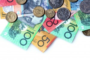 Australian money ~ notes and coins ~ on white background.